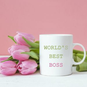 Boss day background with pink tulips. Congratulations for a female boss with space for text.